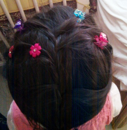 A Simple Braid Prettified with Colorful Clips Preventing her Hair From Falling onto her Face