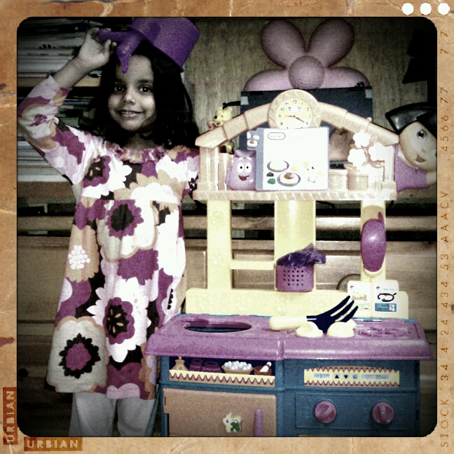 Posing with her new Dora's Kitchen