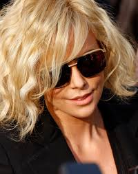 Charlize Theron - I love her hair and sunglasses in this photo. She looks super-cool
