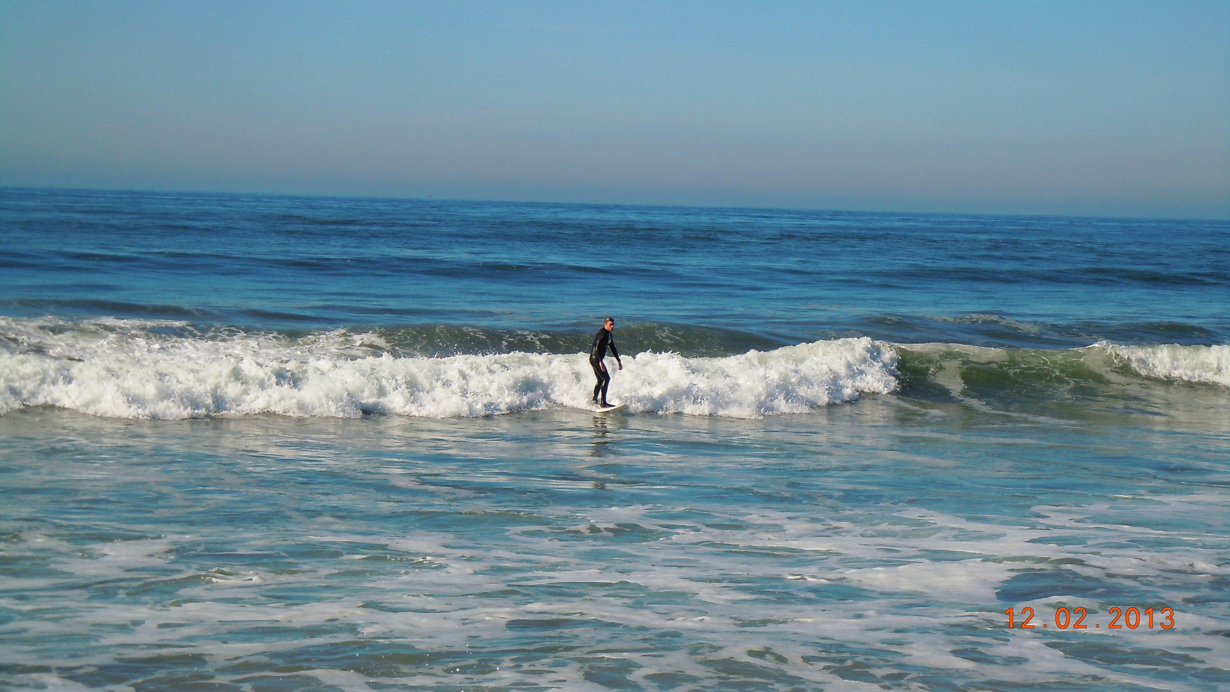 Surfer returning to dry land