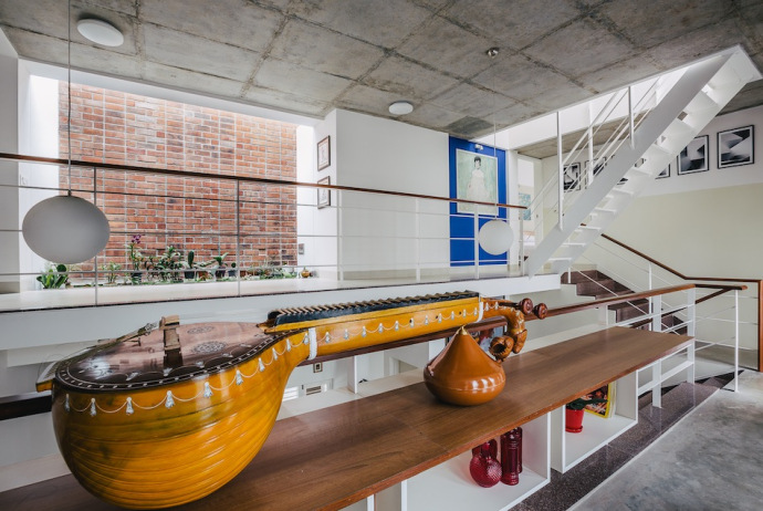 A classical musical instrument (veena) is an interesting addition  to the decor