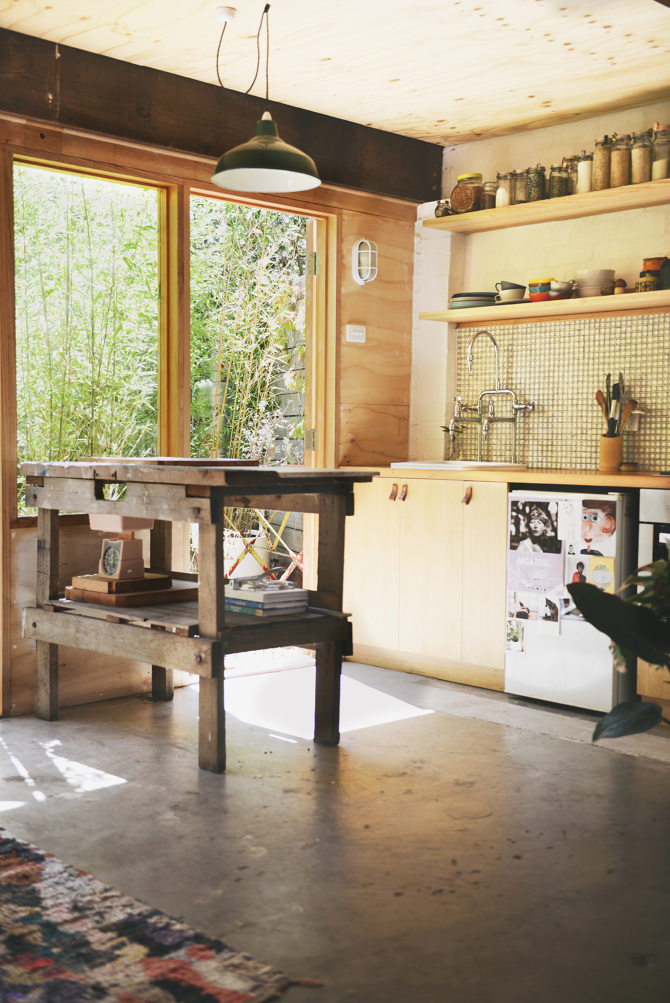 Kitchen area. Love the worn look of the workbench