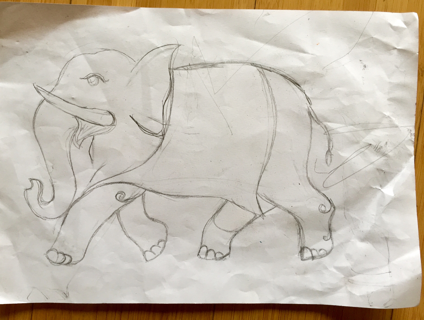 An elephant that I saw crumpled up on the ground