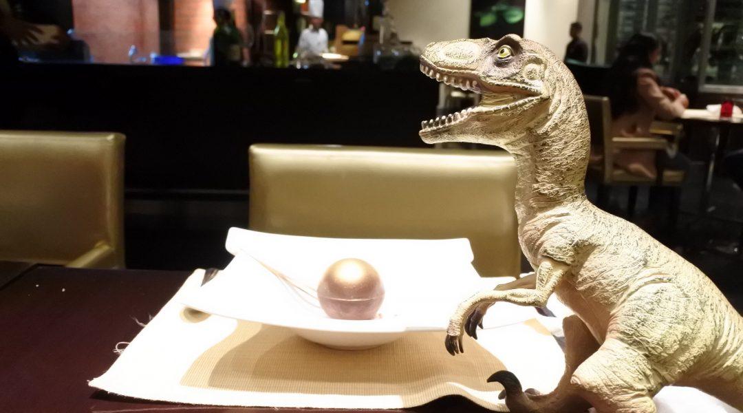 Dinosaur guarding our precious torte caprese