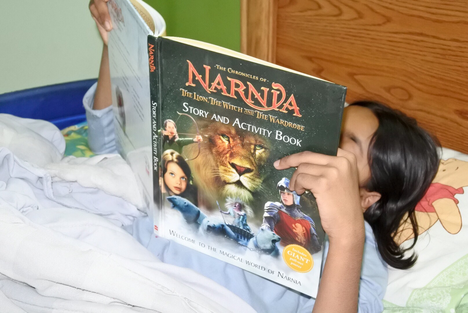 Enjoying her introduction to the world of Narnia
