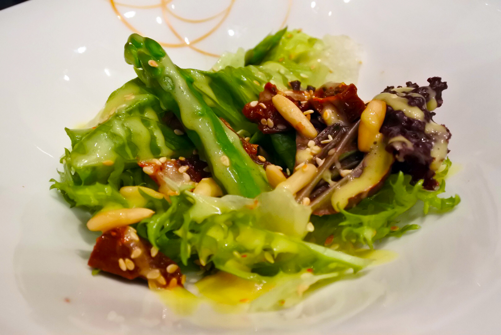 Insalata di asparagi - an asparagus salad with sun-dried tomatoes, sesame seeds, and pine nuts