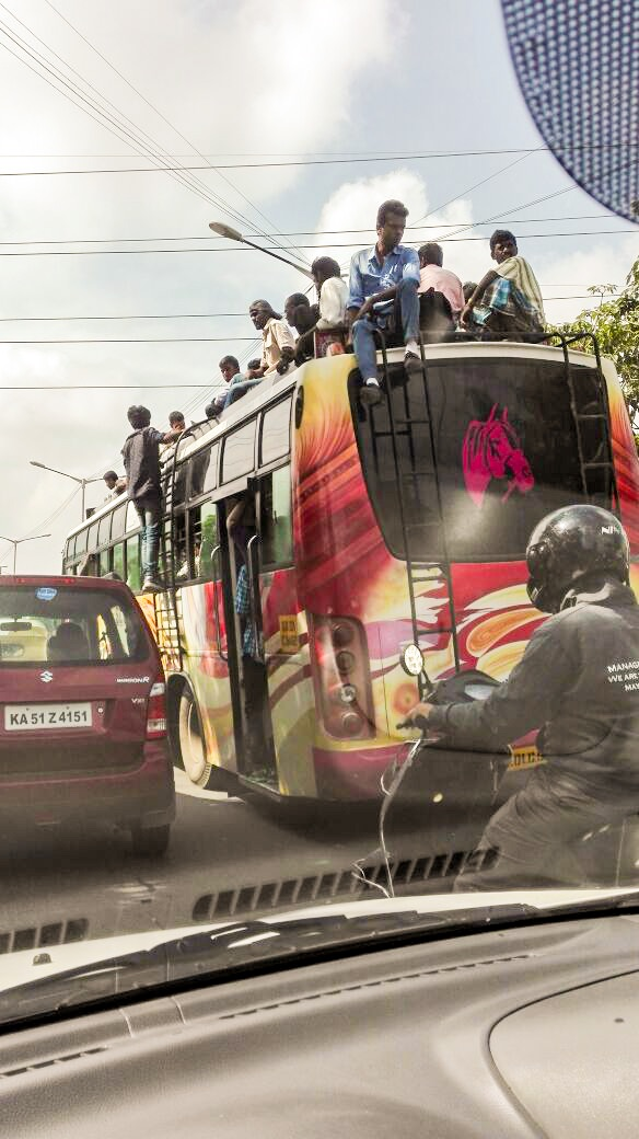 People traveling on top of a bus due to a strike by bus drivers