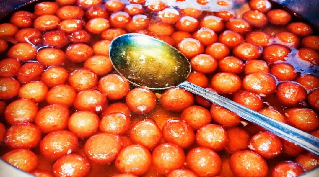 Gulab jamuns in their sugar syrup