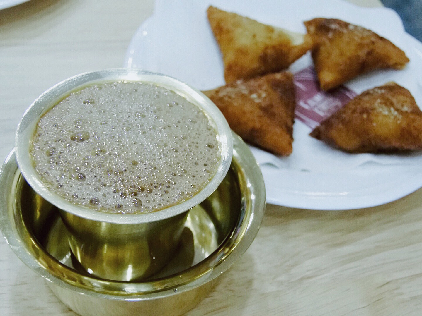 Filter coffee with samosas