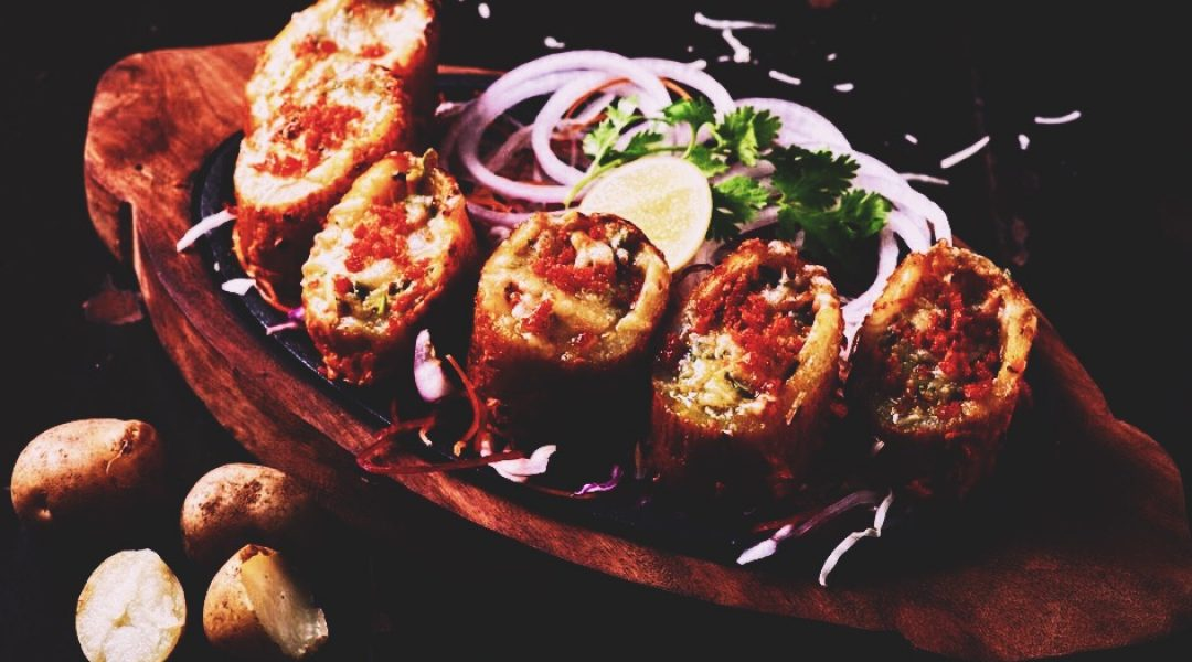 Cheese and vegetables stuffed tandoori aloo